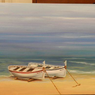 Quadre de Pepita Manzanares de dues barques de pescadors i la platja